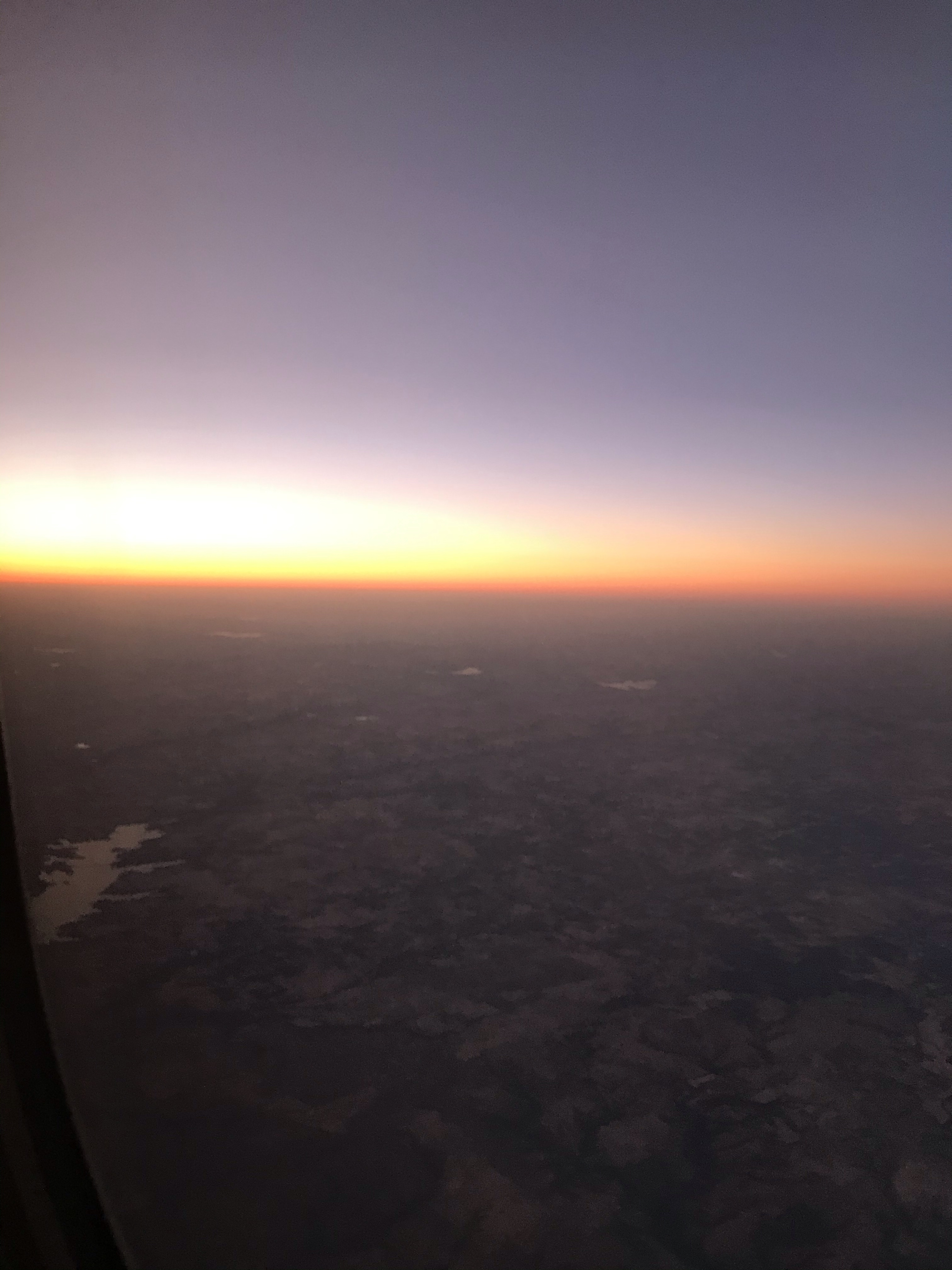 Flying west during sunset